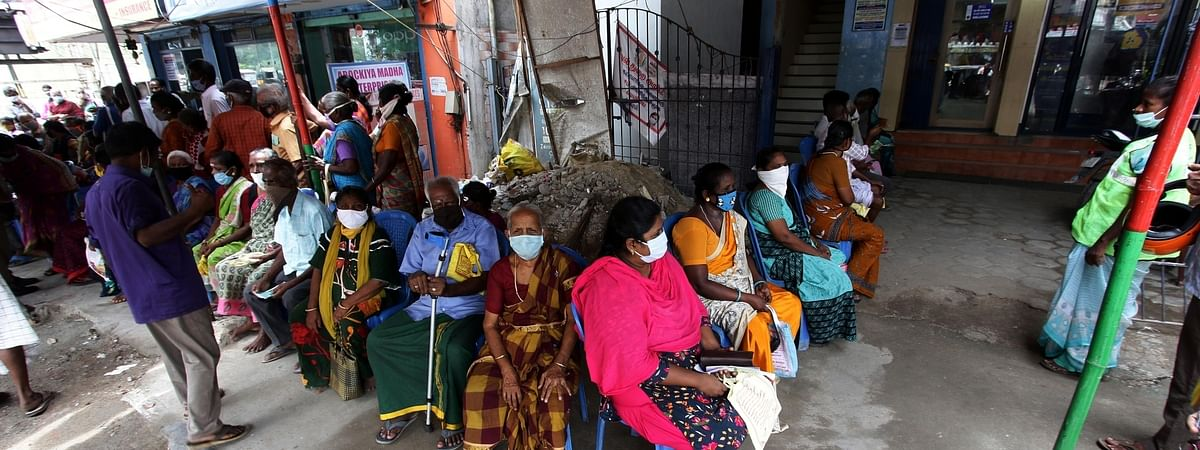 People waiting outside a bank in Chennai during the re-imposed COVID-19 lockdown in the city, on July 14, 2020.