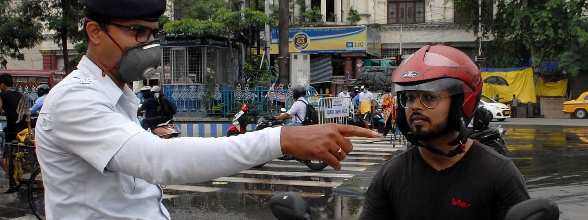 Commuters without masks being intercepted by Kolkata Police personnel amid COVID-19 pandemic during Unlock 2.0, in Kolkata on July 4, 2020.