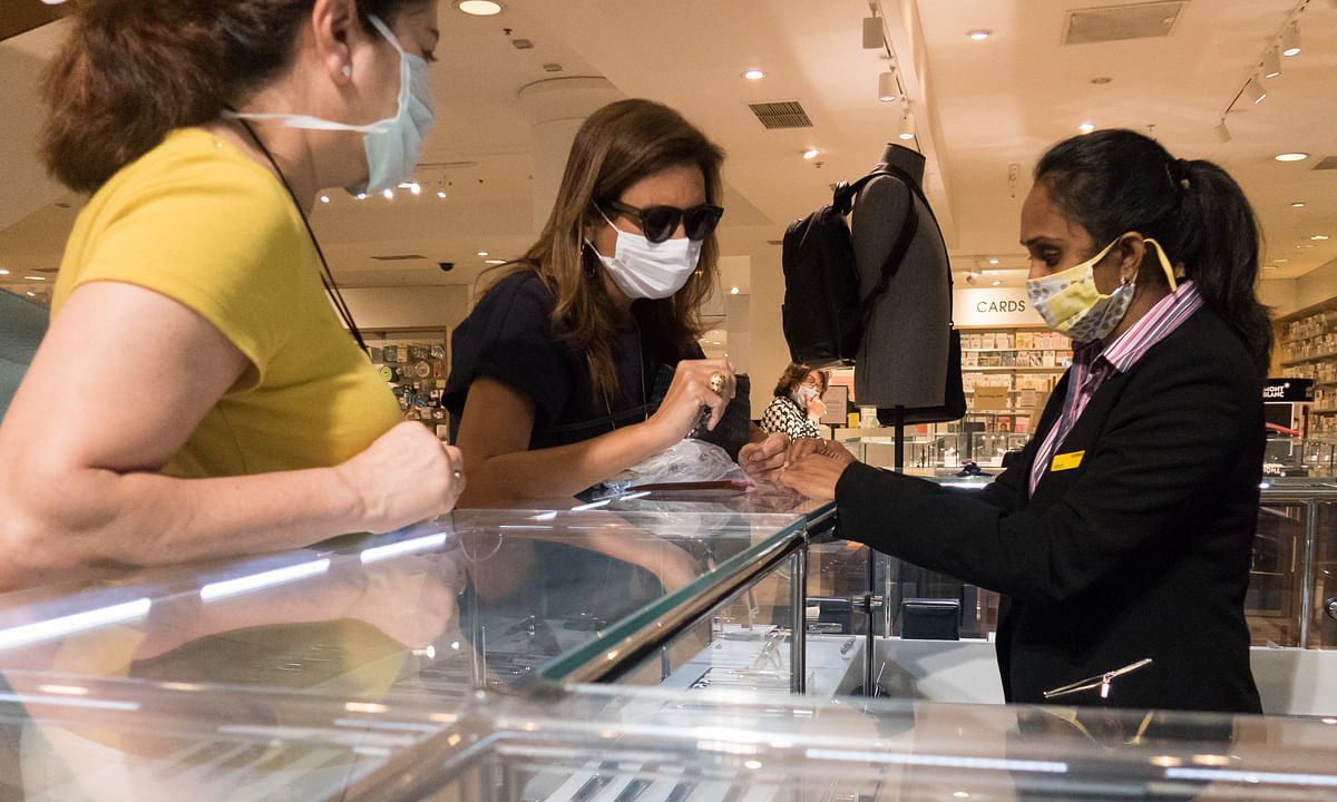People wearing masks while shopping in Selfridges on Oxford Street in London, Britain, on July 24, 2020.