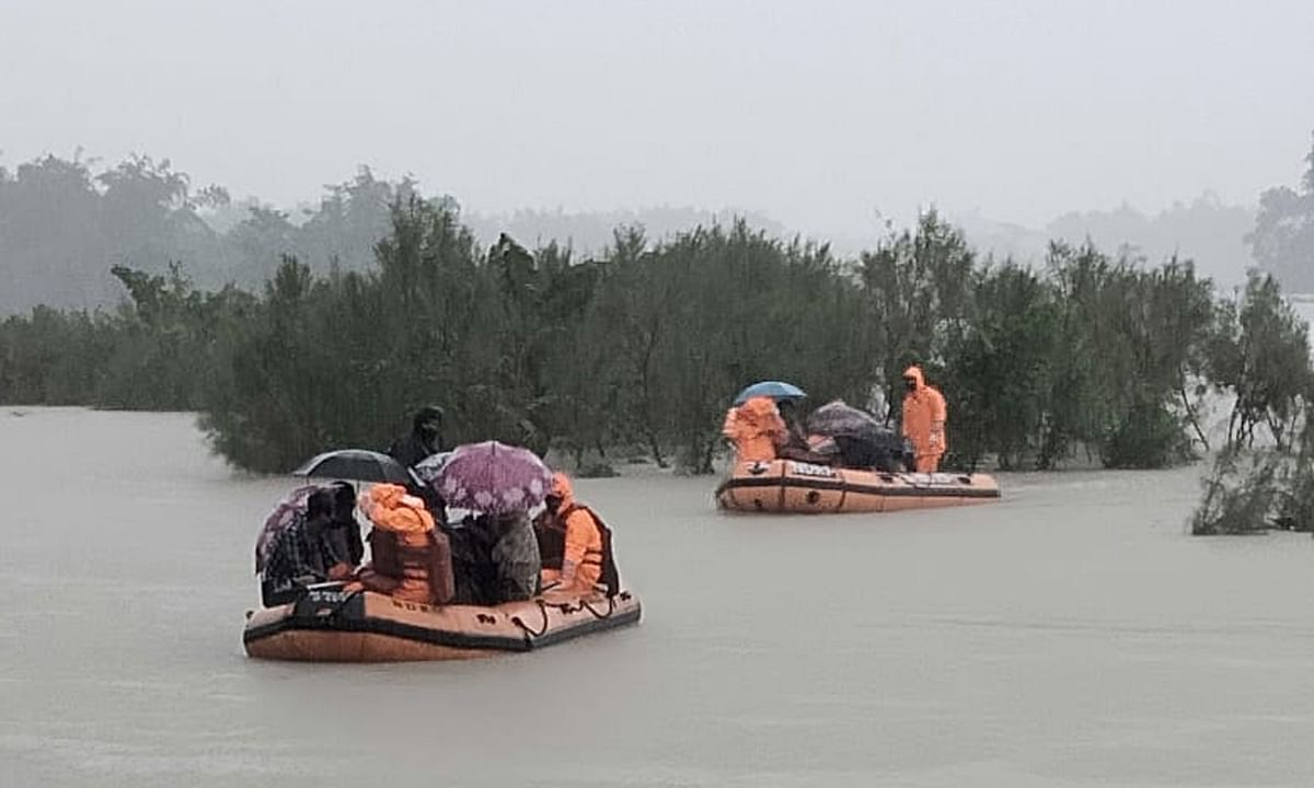 NDRF personal rescuing flood-affected villagers at Hallang Bari under Bajali revenue circle in Barpeta district of Assam on July 11, 2020.