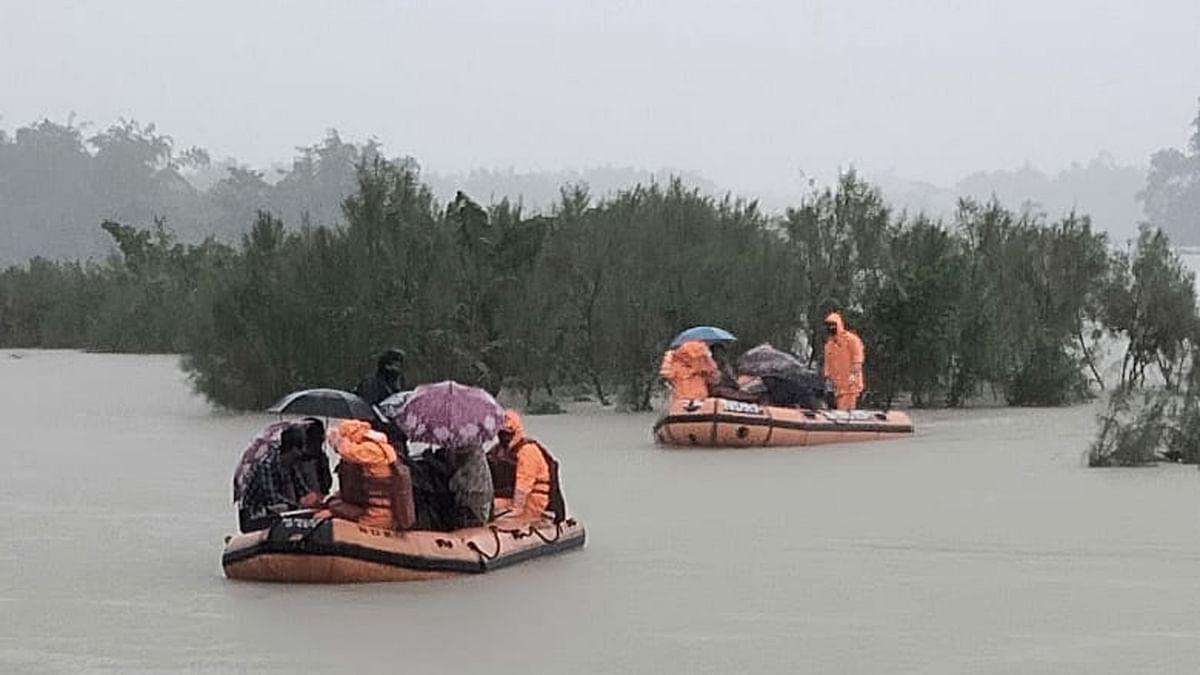 NDRF personal rescuing flood-affected villagers at Hallang Bari under Bajali revenue circle in Barpeta district of Assam on July 11, 2020.