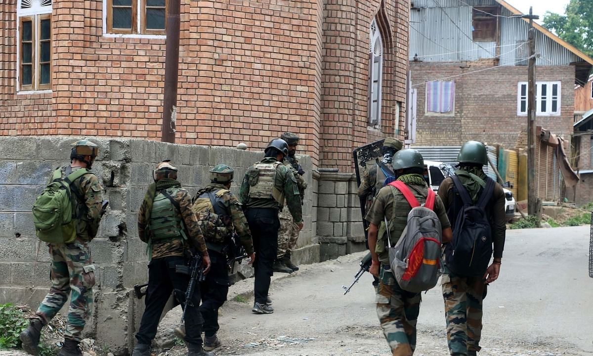 Security personnel carry out cordon and search operations after a terrorist was killed in an encounter at South Kashmir's Kulgam district on July 4, 2020.