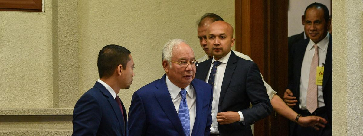 Former Malaysian Prime Minister Najib Razak (2nd L) is seen at a court in Kuala Lumpur, Malaysia at the start of hearings on the corruption charges against him in relation to 1MDB, on August 28, 2019.