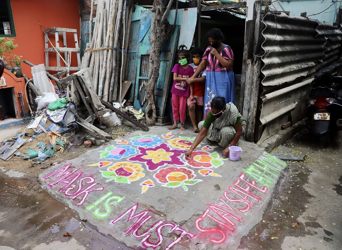Women making colorful rangolis using dry powdered colours in a COVID-19 awareness rangoli- making competition in Chennai on July 27, 2020.