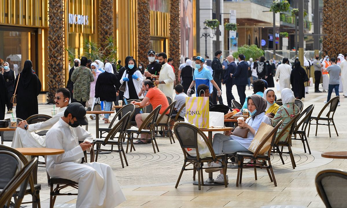 People at a cafe in a shopping mall in Farwaniya Governorate, Kuwait, on August 19, 2020 as the Gulf State enters the fourth stage of restoring normalcy after being hit by the COVID19 pandemic.