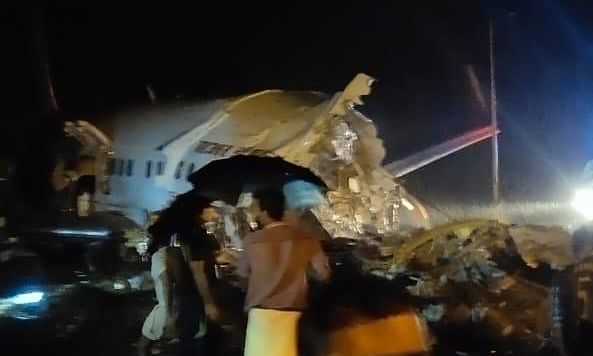 A view of the scene at Kozhikode airport where an Air India Express aircraft skidded off the runway, on August 7, 2020.