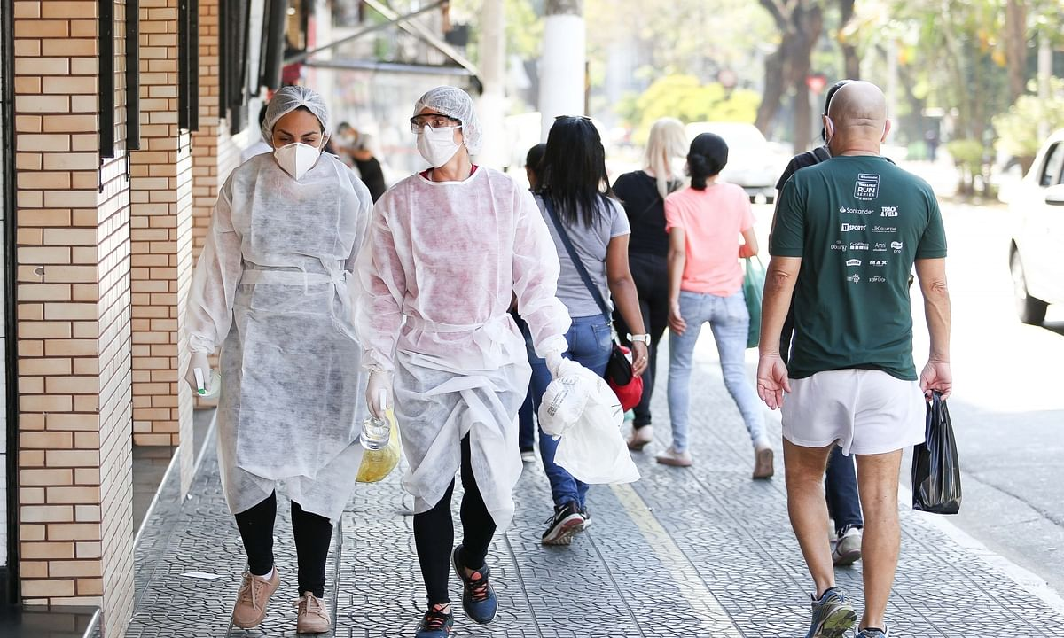 Women in protective suits walking on a street in Sao Paulo, Brazil, on August 13, 2020.