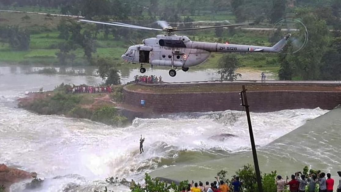An IAF Mi-17V5 helicopter crew carrying out a daring mission to rescue a man stranded in the swirling waters of the waste water weir of the Khutaghat Dam at Ratanpur near Bilaspur in Chhattisgarh on August 17, 2020.