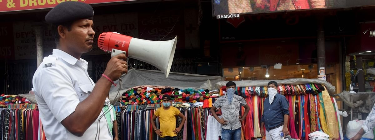 A policeman making announcements at Kolkata's New Market ahead of the biweekly COVID-19 lockdown, on August 26, 2020.