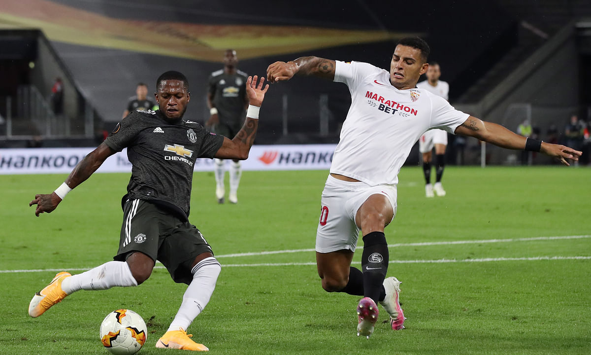Diego Carlos (R) of Sevilla vies with Fred of Manchester United during the UEFA Europa League semifinal in Cologne, Germany, August 16, 2020.