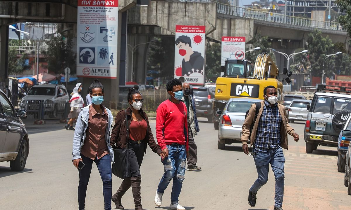 People wearing face masks crossing a busy street in Addis Ababa, capital of Ethiopia, on August 21, 2020.