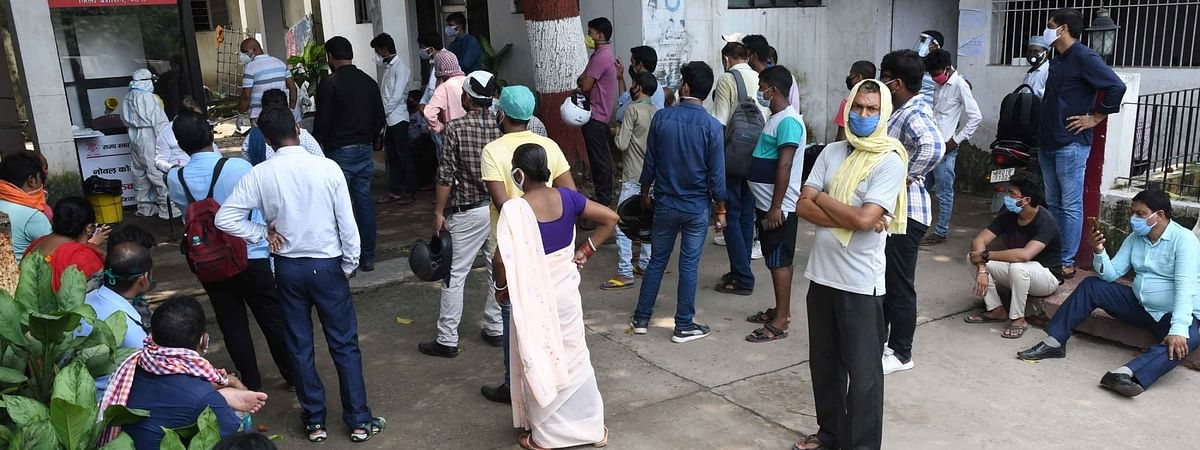 People waiting for their turn to give their samples for COVID-19 testing, outside New Gardiner Road Hospital in Patna on August 4, 2020.