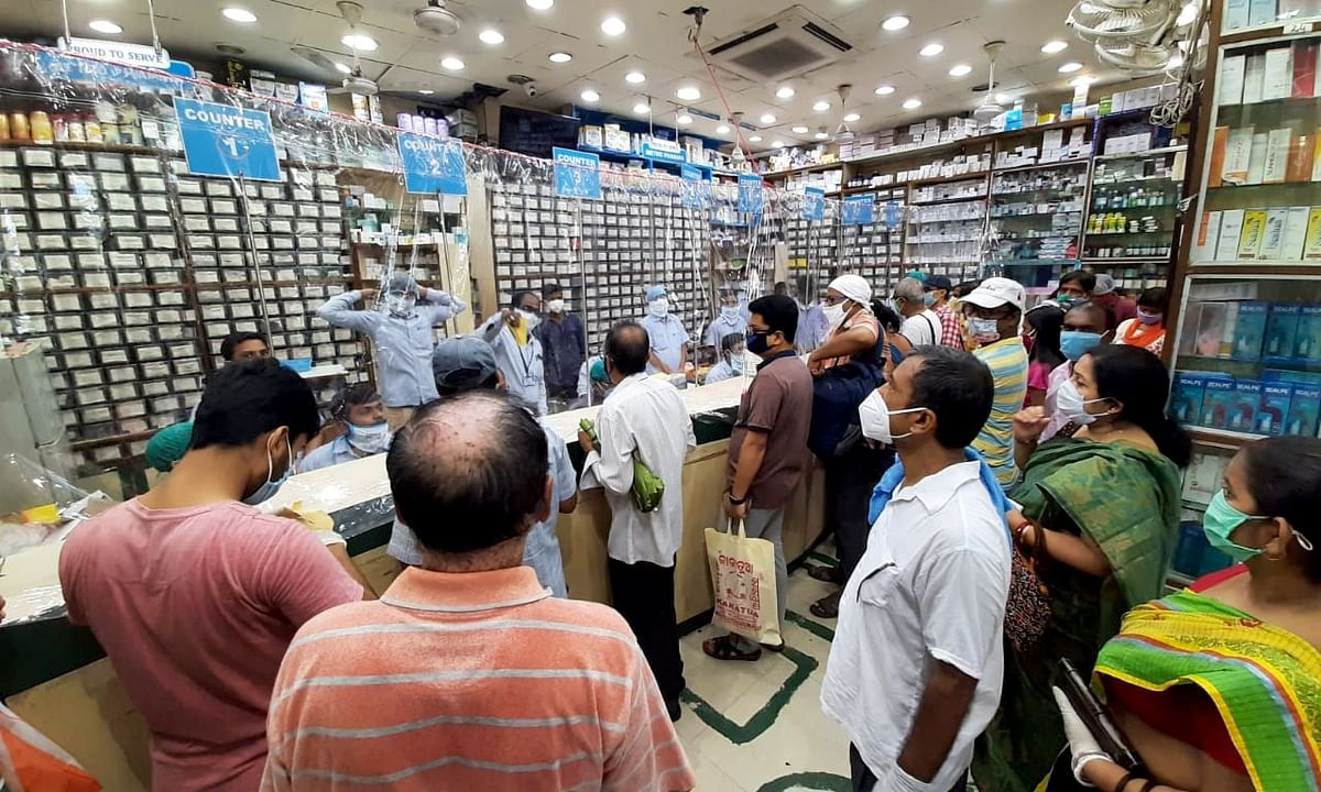 People gathered to stock up essential medicines at a chemist store ahead of a two-day weekly COVID-19 lockdown in Kolkata, on August 19, 2020.