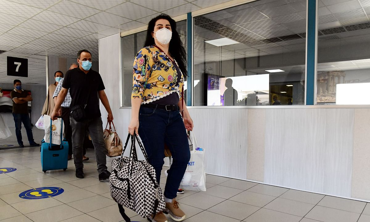 Syrians stranded in Qatar due to the COVID-19 pandemic arriving at  Damascus international airport on August 23, 2020 after they were flown home by a Syrian Airlines flight.