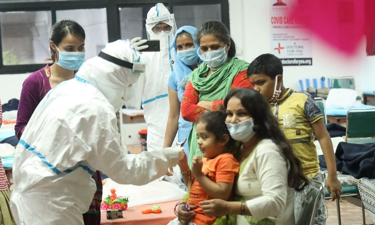India reports 803 more COVID deaths, 52,050 new cases of infection