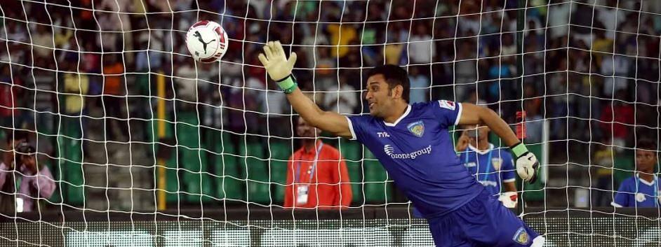 Mahendra Singh Dhoni playing football