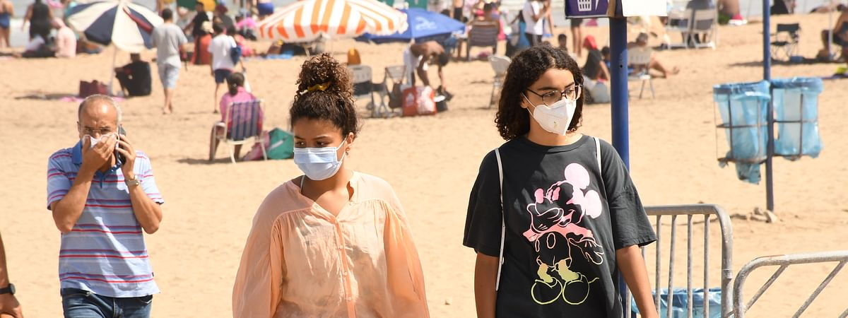 People wearing masks are seen on a beach in Rabat, Morocco, on August 27, 2020.
