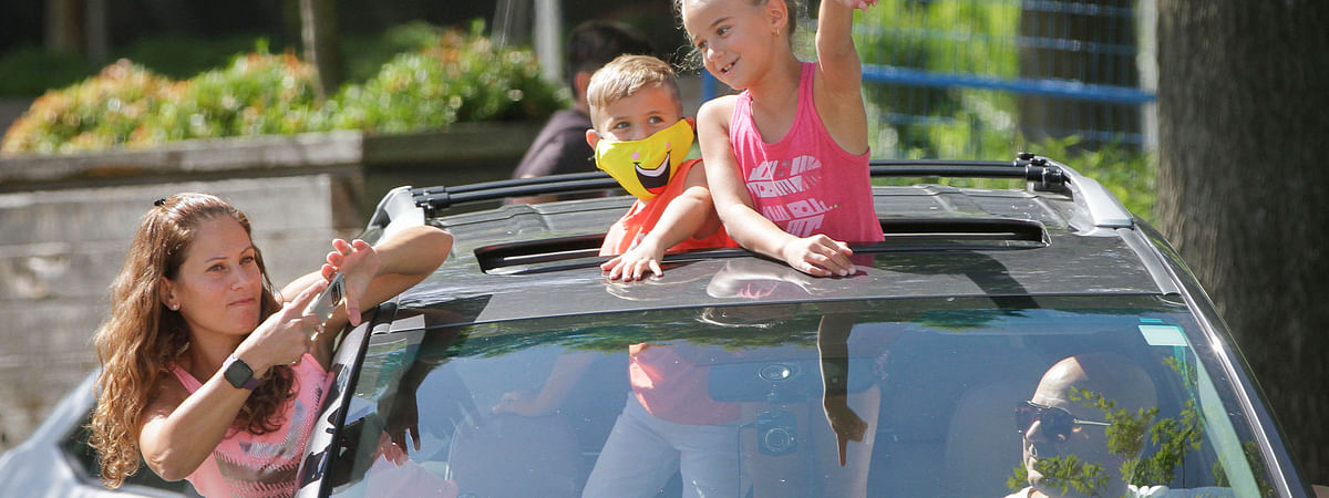 Visitors watching a performance from their car during the Pacific National Exhibition (PNE) Fair in Vancouver, British Columbia, Canada, on August 22, 2020. Due to the COVID-19 pandemic, the fair has been adapted into a drive-thru experience.