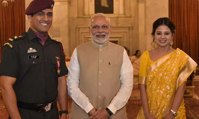 Mahendra Singh Dhoni and his wife Sakshi with Prime Minister Narendra Modi after the cricketer received the Padma Bhushan from President Ram Nath Kovind at Rashtrapati Bhavan, in New Delhi on April 2, 2018.