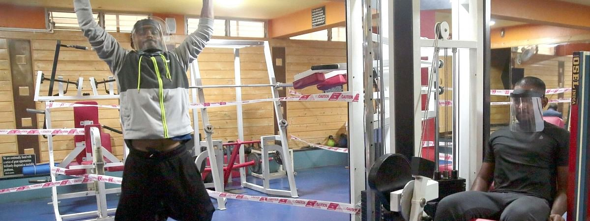People working out at a gym in Bengaluru amid the COVID-19 pandemic after yoga institutes and gymnasiums opened in different parts of India as part of Unlock 3.0 from August 5, 2020.