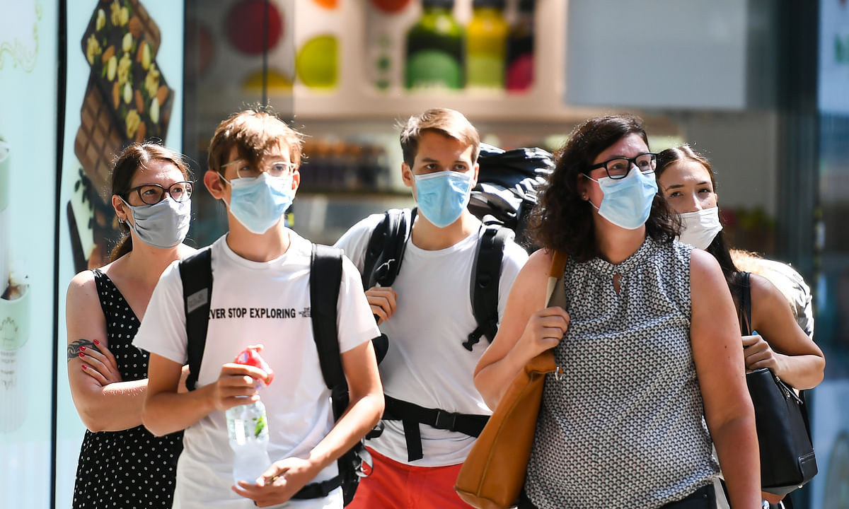 Passengers wearing face masks walking at the Central Railway Station amid the COVID-19 outbreak, in Frankfurt, Germany, on August 16, 2020.