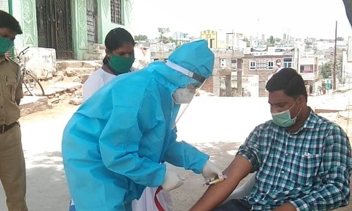 A health worker  taking a sample in rural Telangana, on September 20, 2020.