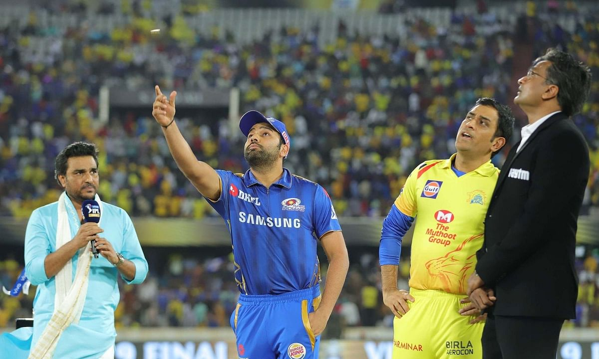 Mumbai Indians captain Rohit Sharma and Chennai Super Kings captain M S Dhoni during the toss ahead of the IPL 2019 final match between the two teams.