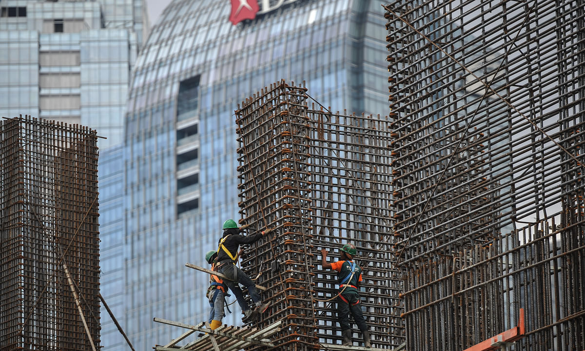 File photo of workers at a construction site in Jakarta, Indonesia.