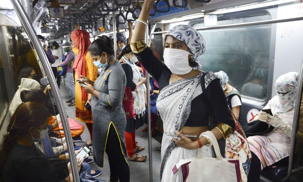 People wearing face masks and face shields while travelling in a metro train amid the COVID-19 pandemic, in Kolkata on September 25, 2020.