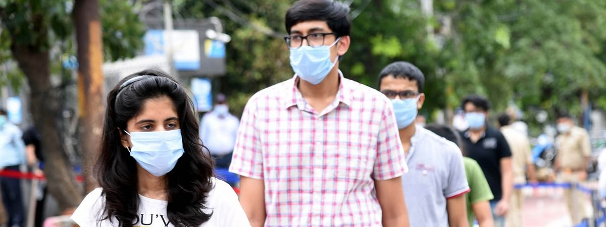 Students wearing masks leaving an examination centre after appearing for the Joint Entrance Examination (JEE) Mains 2020 amid the COVID-19 pandemic, in Noida on September 1, 2020.