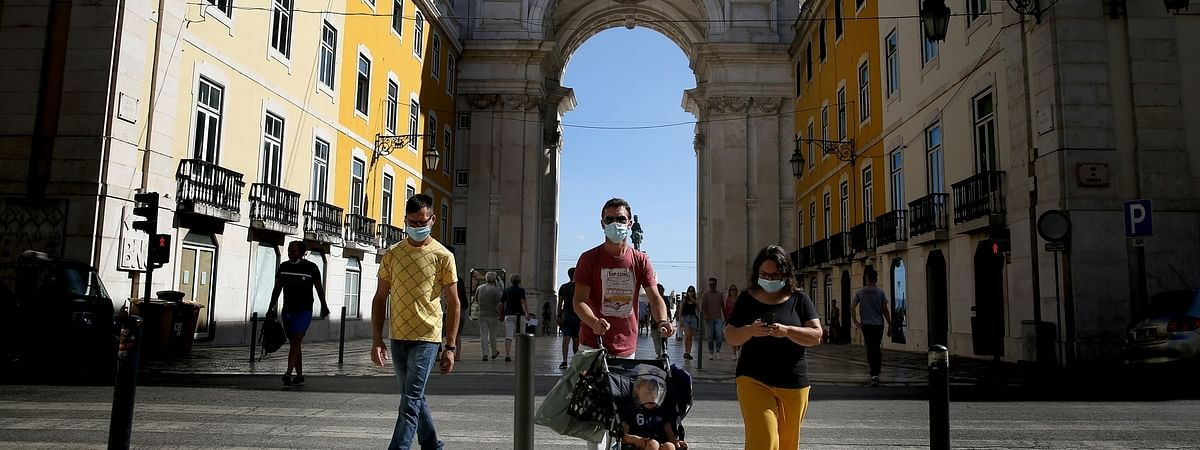People wearing face masks walking on a street in Lisbon, Portugal, on September 15, 2020.