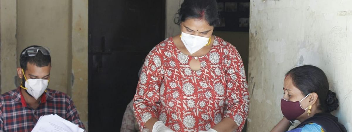 A health worker collecting blood samples for COVID-19 antibody testing, in New Delhi on September 3, 2020.