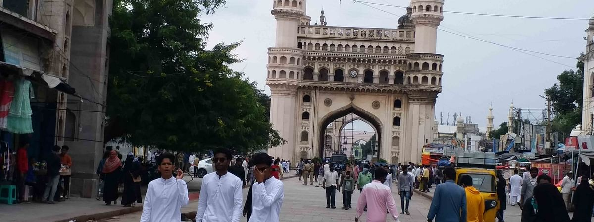 Devotees arrive at the Mecca Masjid to offer Friday prayers as the mosque re-opened amid the COVID-19 pandemic, in Hyderabad on September 11, 2020.
