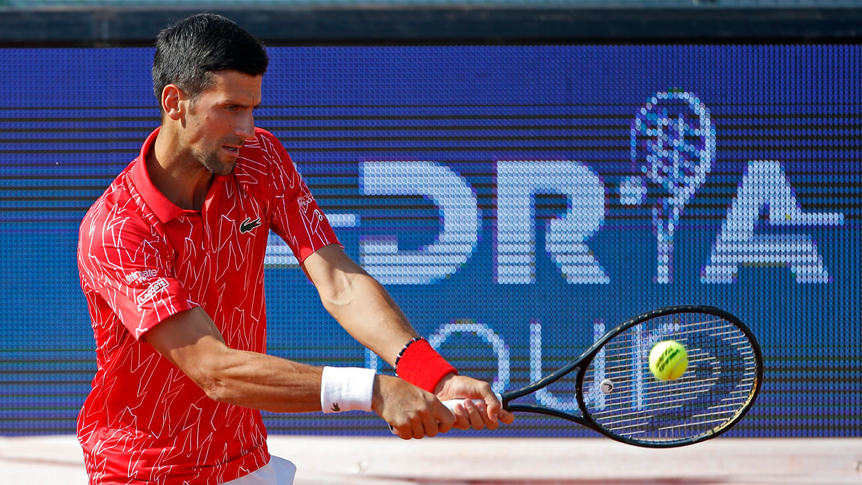 Us Open Djokovic Disqualified After Hitting Line Official With Ball