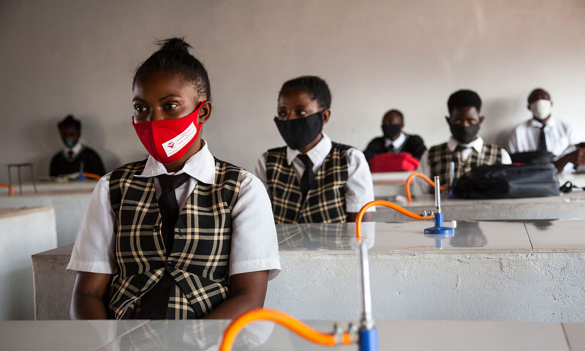 Students wearing face masks attend class at Mejocama Primary and Secondary School in Lusaka, Zambia, on September 21, 2020.