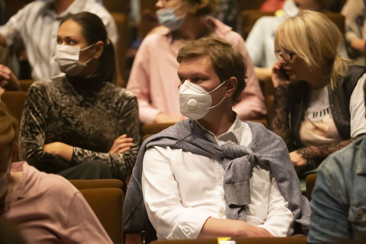 Members of the audience, wearing face masks, waiting for the performance to begin at a theatre in Moscow, Russia, on September 3, 2020. Theatres in Moscow are opening after being closed for months due to the COVID-19 pandemic.