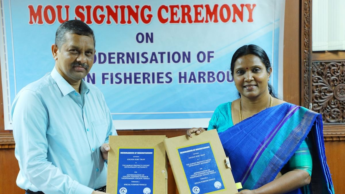 MPEDA Chairman K S Srinivas and Cochin Port Trust Chairperson Dr M Beena at the signing of an MoU to modernise the Cochin Fishing Harbour, in Kochi on September 28, 2020.