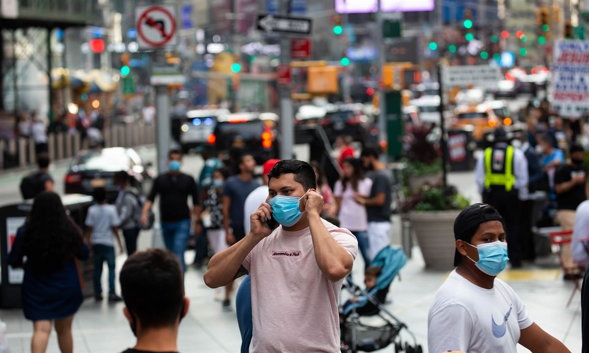 People walking in Times Square during the COVID-19 pandemic in New York, the United States, on September 13, 2020.