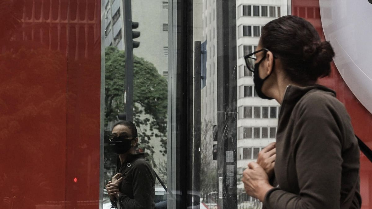 A pedestrian wearing a mask walking on a street amid the COVID-19 outbreak in Sao Paulo, Brazil on September 17, 2020.