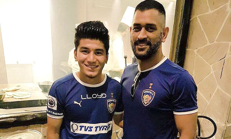 Footballer Anirudh Thapa with cricketer M S Dhoni