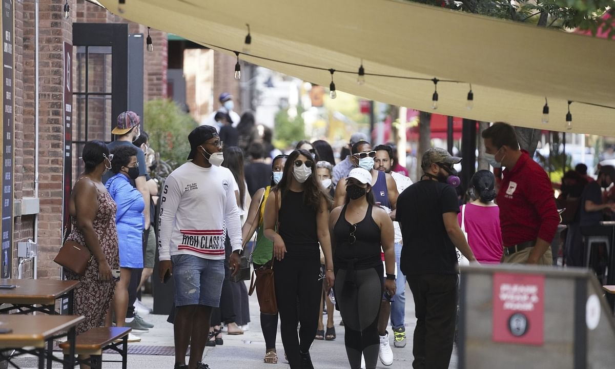 People seen at the outdoor catering zone of the Chelsea Market in New York, the United States, on September 7, 2020.