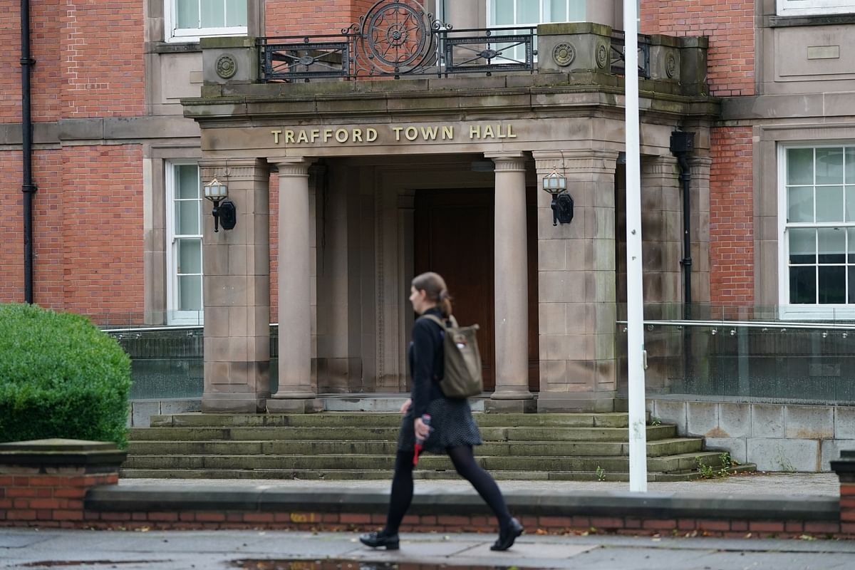 A woman walks past Trafford Town Hall in Greater Manchester, Britain on September 2, 2020. According to BBC, parts of Greater Manchester will not have lockdown restrictions eased as planned following a government U-turn.