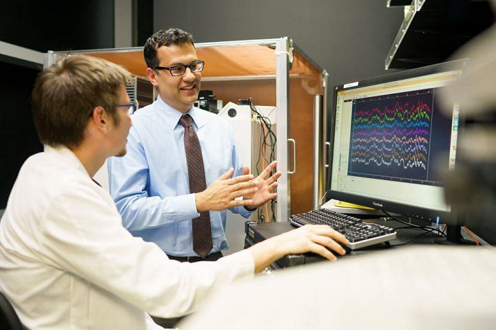 Karunesh Ganguly (right), MD, PhD, discusses ECoG brain recording data with student Stefan Lemke in 2016.