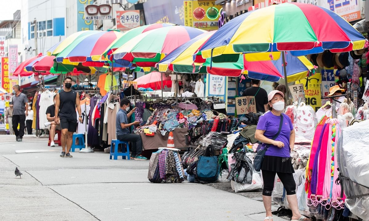 Shop owners, wearing face masks, waiting for customers at Namdaemun Market in Seoul, South Korea, on September 1.