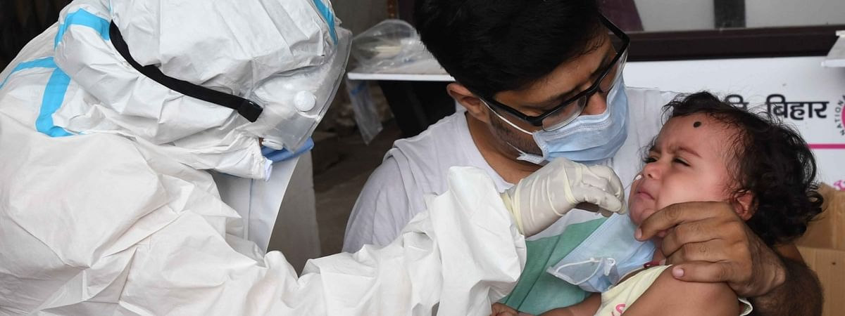 A health worker collecting swab samples for COVID-19 testing, outside New Gardiner Road Hospital in Patna on Septembber 15, 2020.