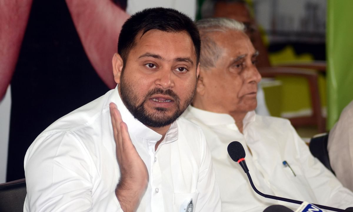 RJD leader Tejashwi Yadav addressing a press conference after releasing the party's election manifesto ahead of Bihar Assembly elections, in Patna on October 24, 2020.