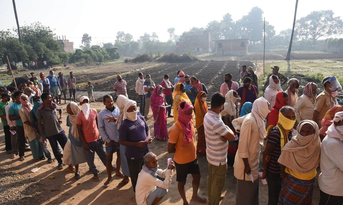 Voters queueing up to cast their votes in the first phase of Bihar Assembly elections, at Sarwan in Gaya district on October 28, 2020.
