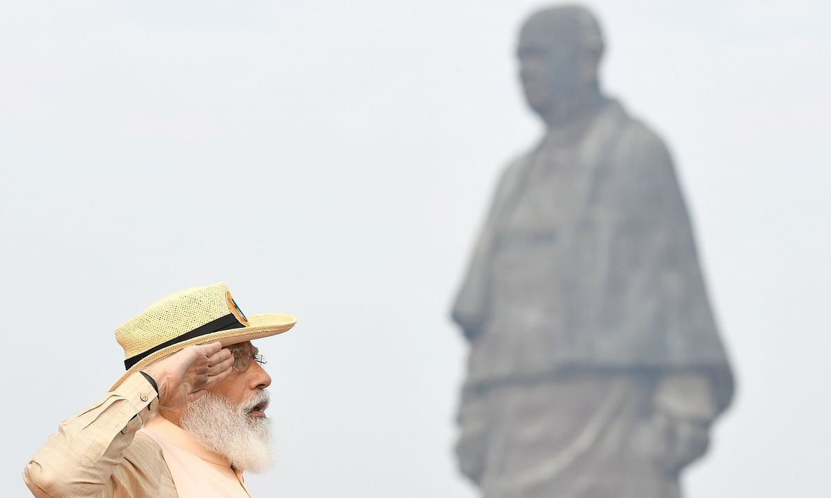 Prime Minister Narendra Modi taking the salute at a parade held at the Statue of Unity to mark the birth anniversary of Sardar Vallabhbhai Patel at Kevadia in Gujarat, on October 31, 2020.