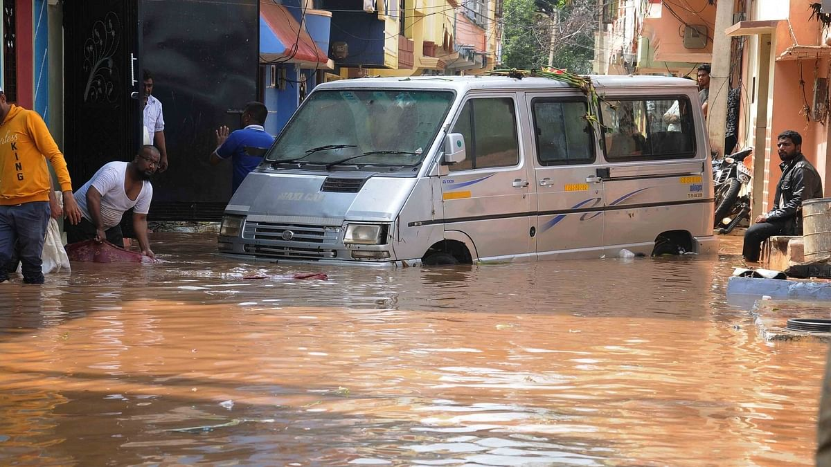 Roads blocked due to waterlogging after heavy rains in Hafeez Baba Nagar in Hyderabad on October 18, 2020.