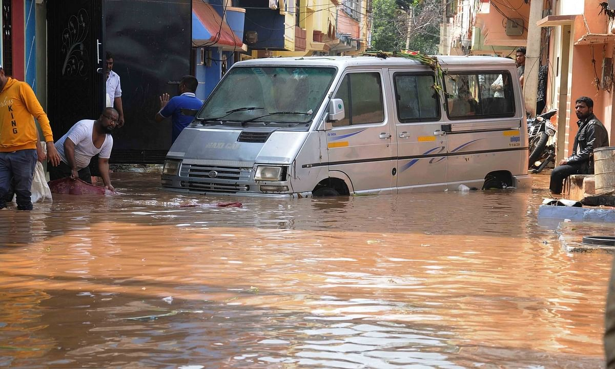 Roads blocked due to waterlogging after heavy rains in Hafeez Baba Nagar in Hyderabad on October 18, 2020.